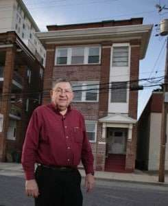 Charles Birnbaum, standing in front of his house, which the CRDA tried to condemn.