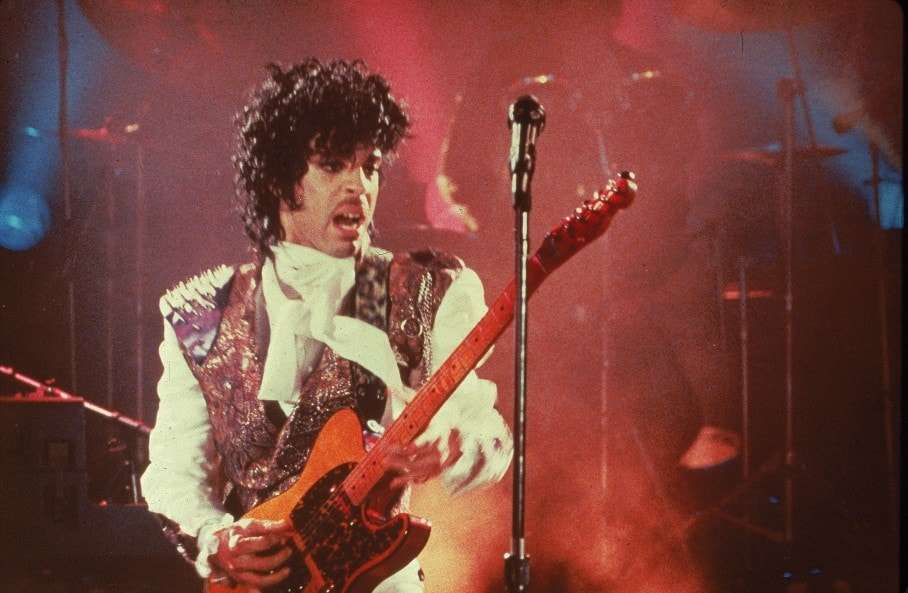 """SLUG: ST/SHOPPER16 INPUTDATE: 2008-10-15 17:21:32.887 CREDIT: handout/FROM_PHOTOPOST/AP Photo LOCATION: x, , x CAPTION: FILE--Prince performs in his debut movie """"Purple Rain,"""" the 1984 rock opera about a young man's search for artistic accomplishment and love. (AP Photo) Sent by: Michael Cotterman Photo Editor:"""
