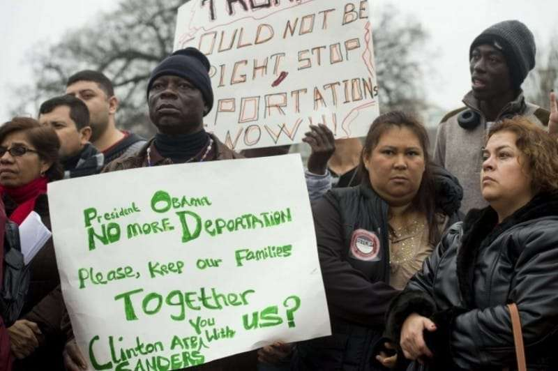 Immigrants and their supporters protest planned raids to deport illegal immigrants during a rally next to the White House in December. (Saul Loeb/AFP/Getty Images).