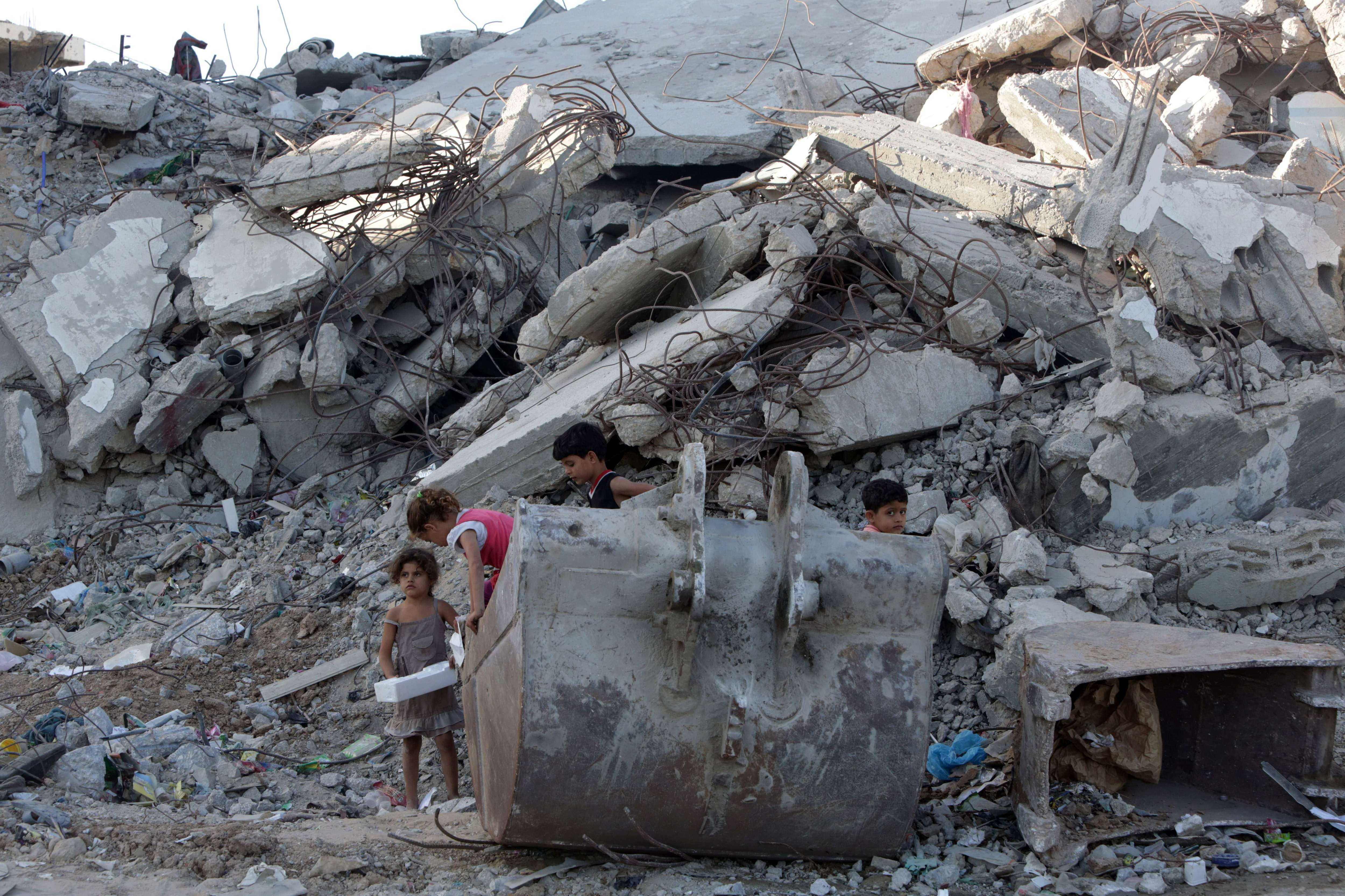 Palestinian children play in the rubble of buildings on June 22, 2015 in Gaza City that were destroyed during 50-day war between Israel and Hamas-militants in the summer of 2014. (Mahmud Hams/AFP/Getty Images)
