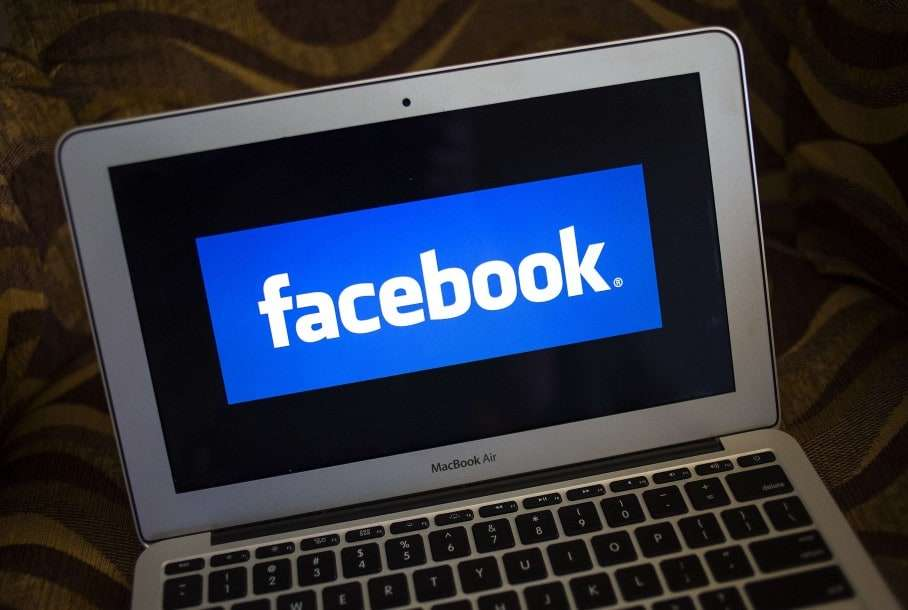 A Facebook logo is shown on a notebook in Ventura, California in this December 21, 2013 file photo. Facebook has more than 400 employees in Seattle, up from 125 only two years ago, vastly outstripping the social network's overall growth. It recently took over a second floor in its rented offices to handle the overflow, and is starting to fill a third. REUTERS/Eric Thayer/Files (UNITED STATES - Tags: BUSINESS LOGO)