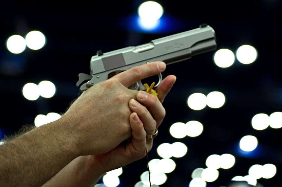 """(FILES) In this May 4, 2013 file photo, a convention goer picks up a Ruger 1911 model .45 semi-auto gandgun at the NRA Annual Convention May 4, 2013 in Houston, Texas."""" AFP PHOTO / Karen BLEIER / FILESKAREN BLEIER/AFP/Getty Images"""