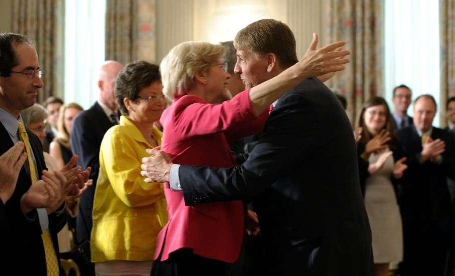 Richard Cordray, right, the new director of the Consumer Financial Protection Bureau, talks with Sen. Elizabeth Warren, D-Mass., left, following a statement by President Barack Obama in the State Dining Room of the White House in Washington, Wednesday, July 17, 2013. The Senate voted on Tuesday, July 16, 2013, to end a two-year Republican blockade that was preventing Cordray from winning confirmation as director of the Consumer Financial Protection Bureau. Warren, who came up with the original idea for the CFPB, has aggressively pushed for the confirmation of Cordray, who received a recess appointment from the president in January 2012. (AP Photo/Susan Walsh)