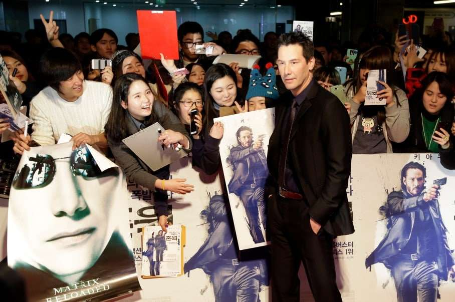 """Actor Keanu Reeves poses for photographers during the red carpet event for his movie """"John Wick"""" in Seoul, South Korea, Thursday, Jan. 8, 2015. (AP Photo/Lee Jin-man)"""