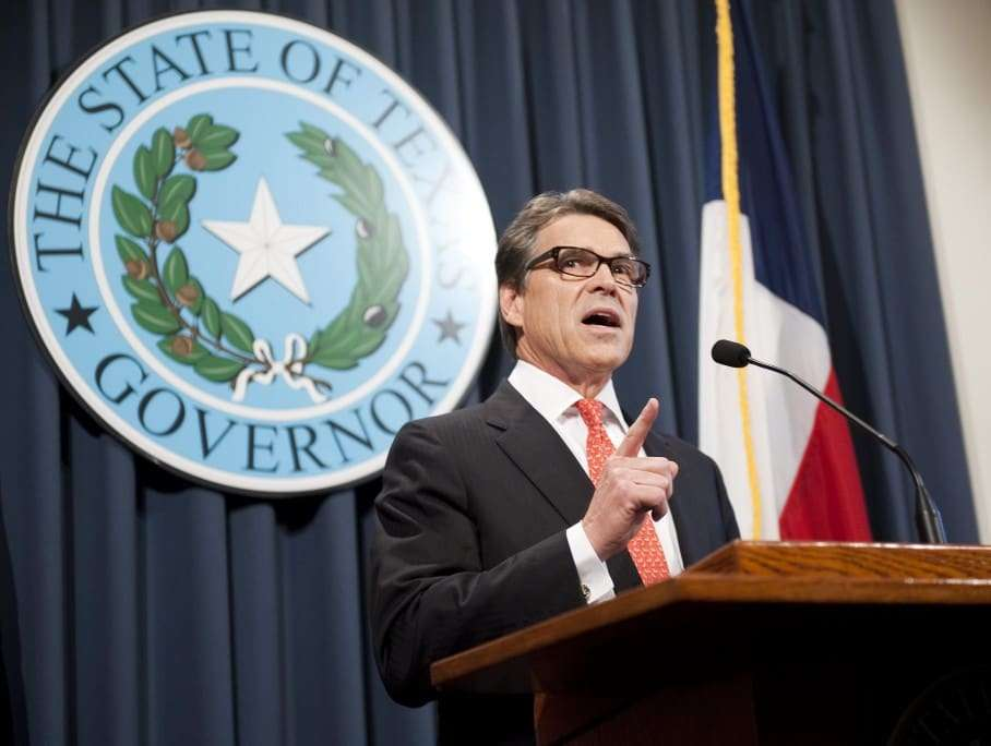 epa04357042 Texas Governor Rick Perry makes a statement regarding his grand jury indictment on charges of abuse of power at the Texas state capitol, in Austin, Texas, USA, 16 August 2014. Texas Governor Rick Perry lashed out at an indictment against him for abuse of power, calling it a political ploy against him. The Republican governor, who is seen as a possible candidate for president in 2016, was indicted on 15 August on two counts of abuse of power for allegedly threatening to veto funding for a district attorney's office in a bid to force her to resign. 'I am confident that we will ultimately prevail, that this farce of a prosecution will be revealed for what it is, and those responsible will be held accountable,' Perry told a press conference in Texas state capital Austin. EPA/ASHLEY LANDIS