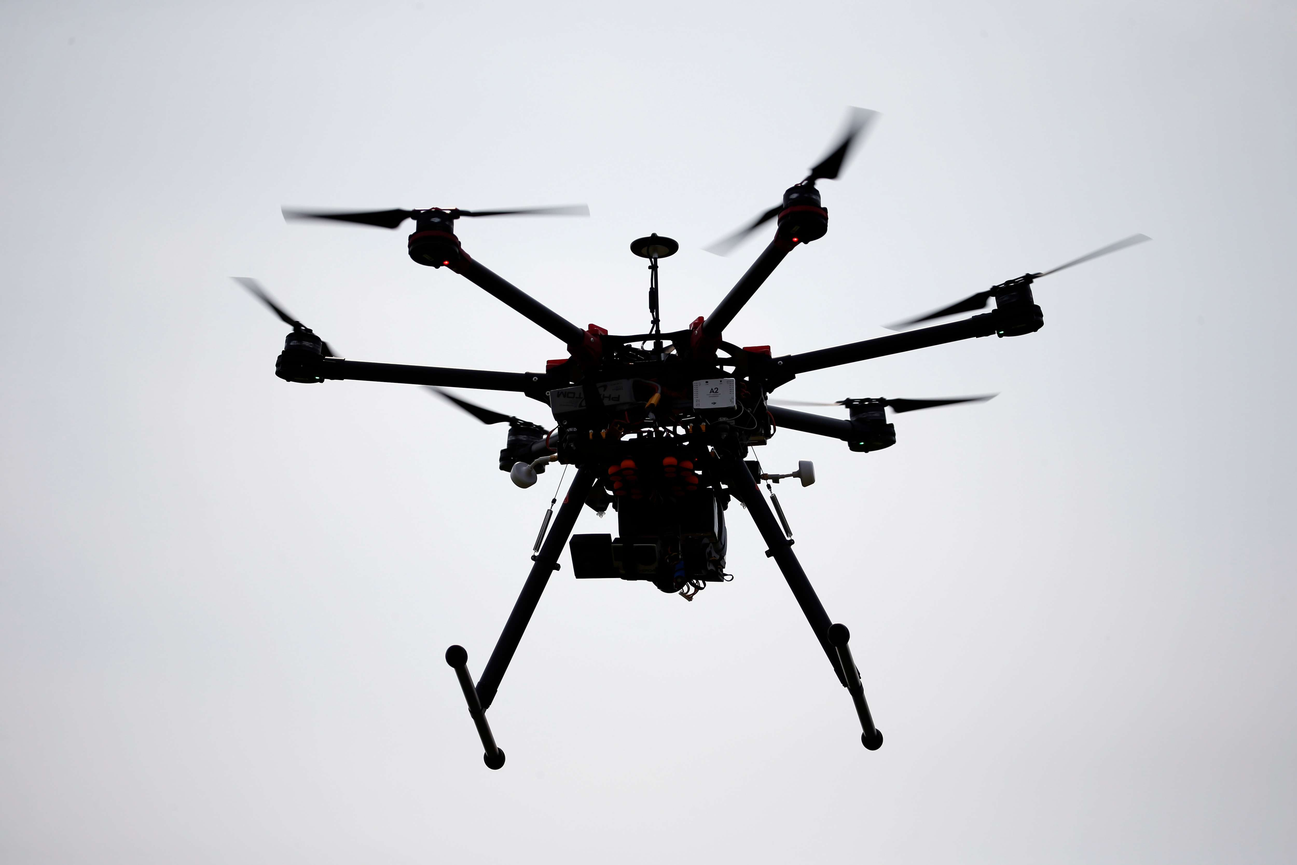 A hexacopter drone is flown during a drone demonstration at a farm and winery on potential use for board members of the National Corn Growers, Thursday, June 11, 2015 in Cordova, Md. (AP Photo/Alex Brandon)