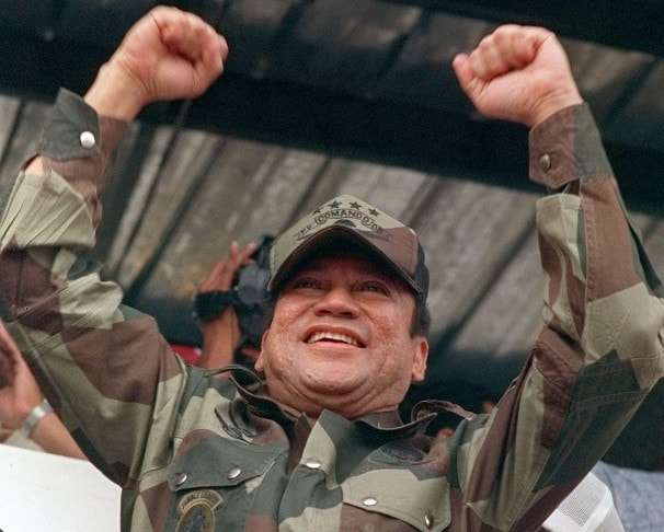 Panamanian military strongman Gen. Manuel Antonio Noriega raises his fists to acknowledge the crowd cheers during a Dignity Batallion rally in Panama City on May 20, 1988. U.S. pressure to force Noriega out of power had so far failed. (AP Photo/John Hopper)