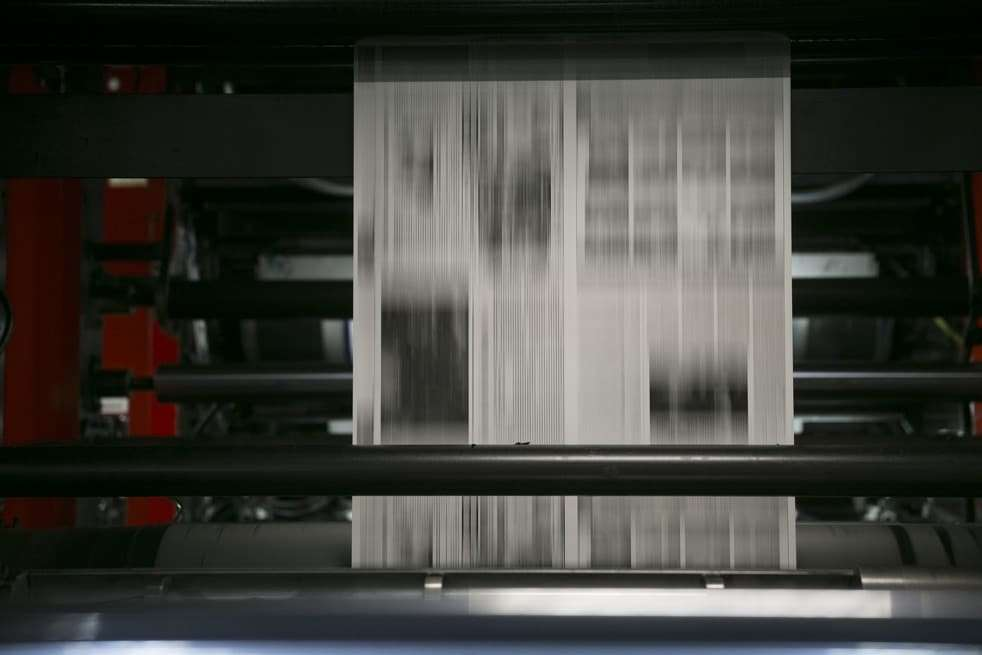 Newsprint runs through the printing cylinders of a Mitsubishi Heavy Industries Ltd. newspaper press at the Washington Post newspaper production facility in Springfield, Virginia, U.S., on Friday, July 12, 2013. (Andrew Harrer/Bloomberg)