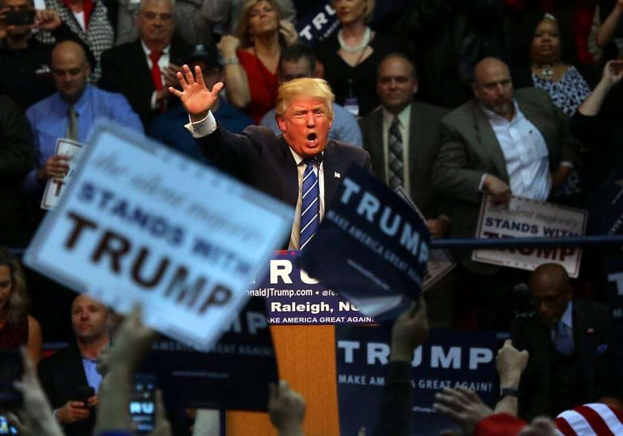 Republican presidential candidate Donald Trump energizes the crowd during a campaign rally at Dorton Arena in Raleigh, N.C., Friday, Dec. 4, 2015. (AP Photo/Ted Richardson)