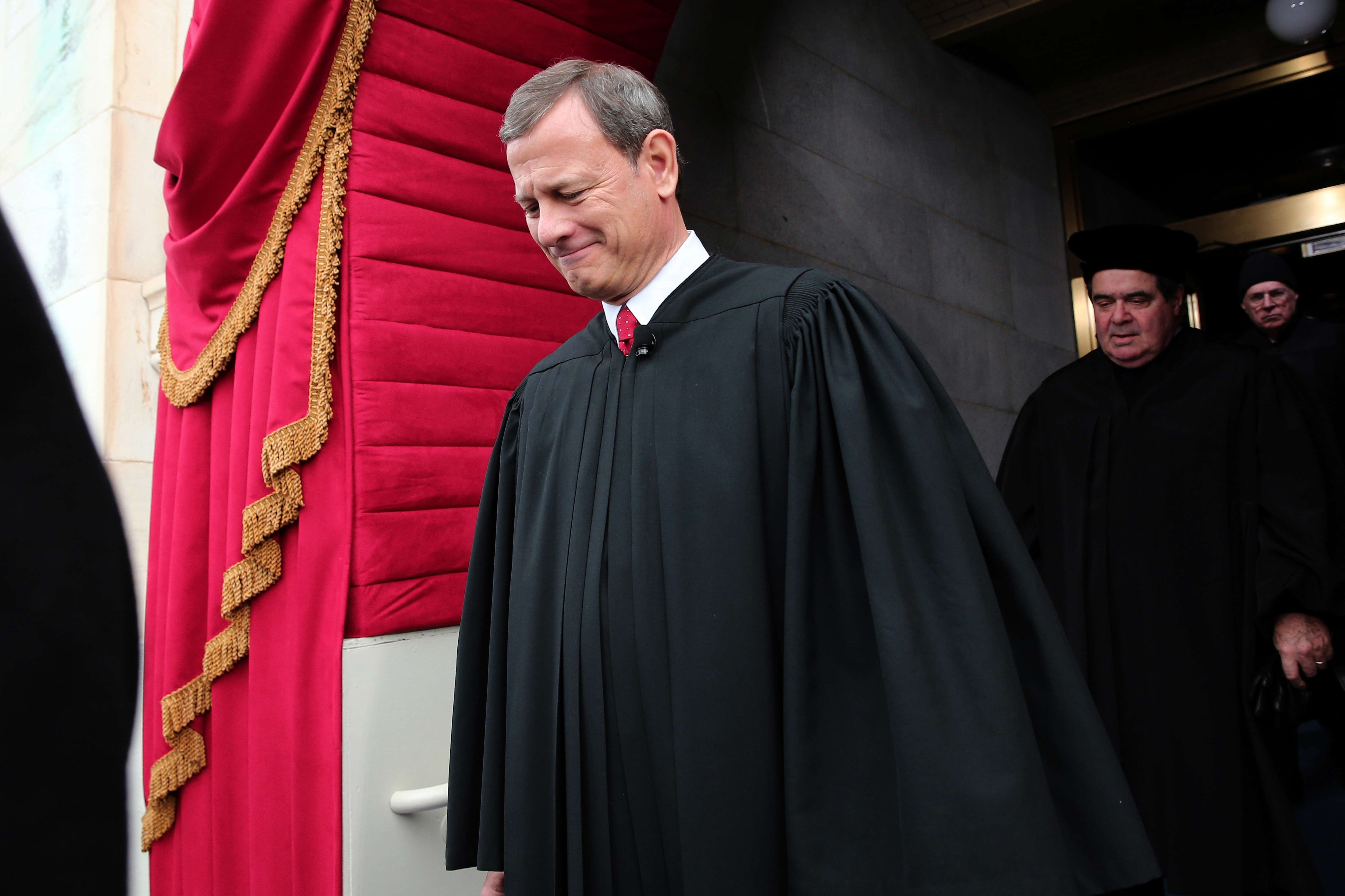WASHINGTON, DC - JANUARY 21: Supreme Court Chief Justice John Roberts arrives during the presidential inauguration on the West Front of the U.S. Capitol January 21, 2013 in Washington, DC. Barack Obama was re-elected for a second term as President of the United States. (Photo by POOL Win McNamee/Getty Images)