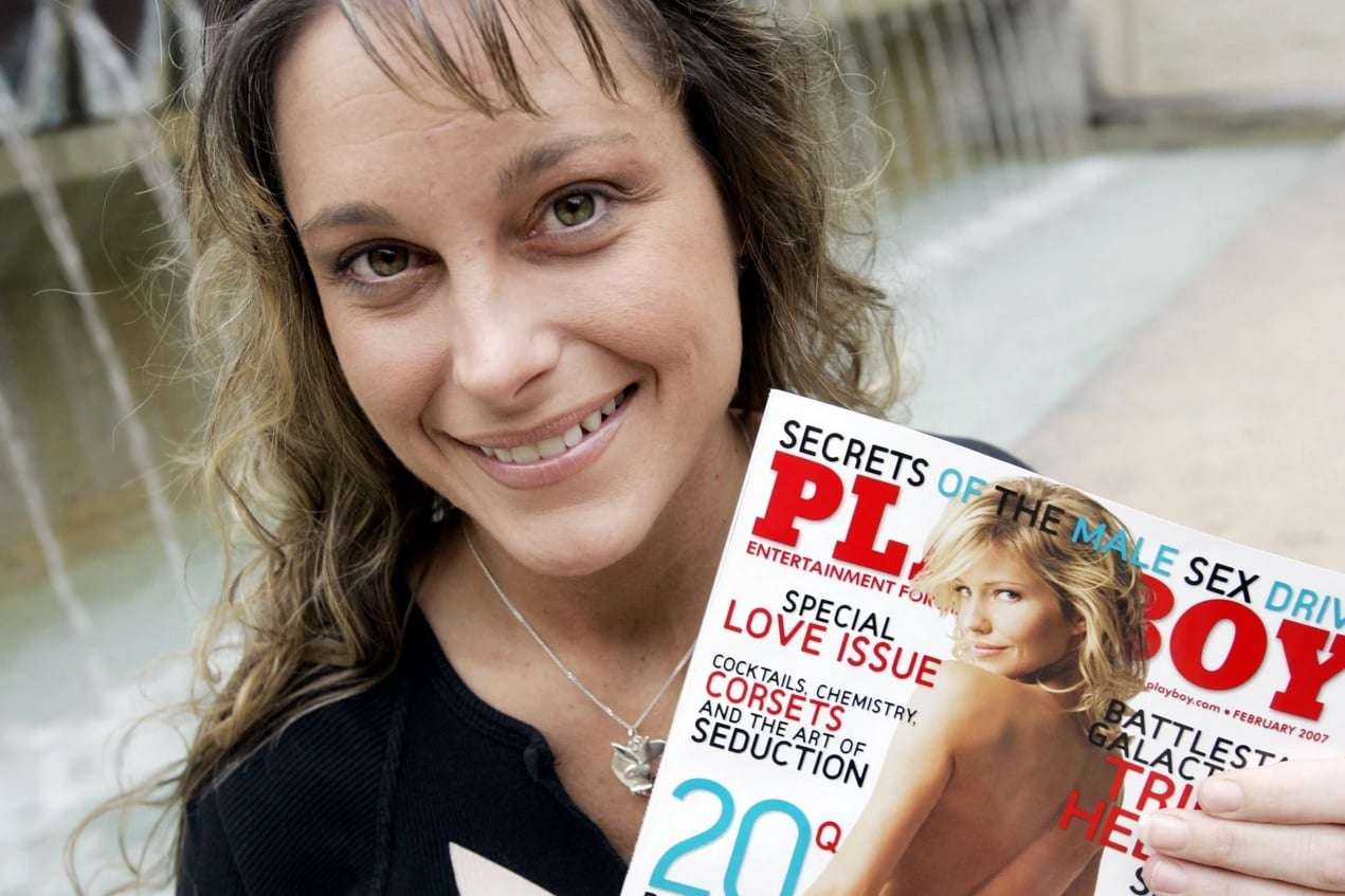U.S. Air Force Staff Sgt. Michelle Manhart poses with the February issue of Playboy magazine in San Antonio in January 2007. (Eric Gay/AP)